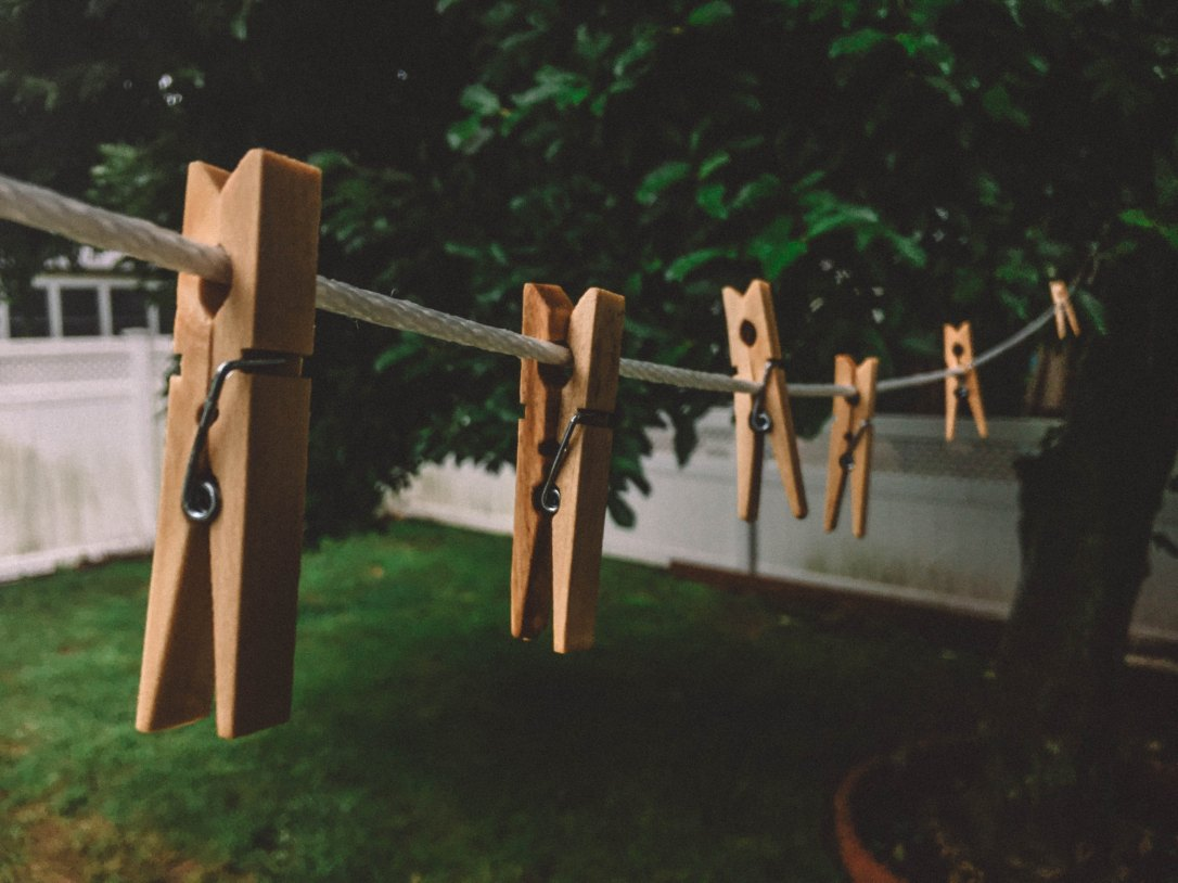 Clothespegs on washing line. Photo by Kyle Arcilla on Unsplash